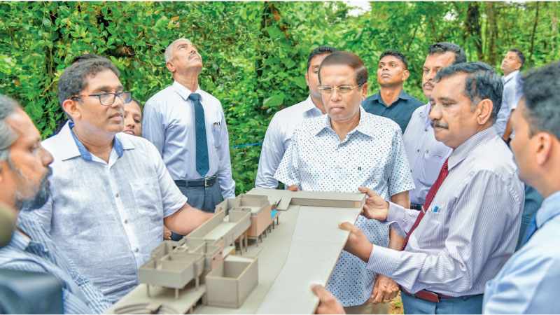 President Maithripala Sirisena  is shown a model of the Pandit Amaradeva Music Centre, when he visited the construction site recently. Picture courtesy President's Media Division