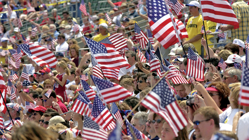 Supporters wave U.S. flags as they attend the Rally for America event at Marshall University Stadium on May 24, 2003 in Huntington, West Virginia.