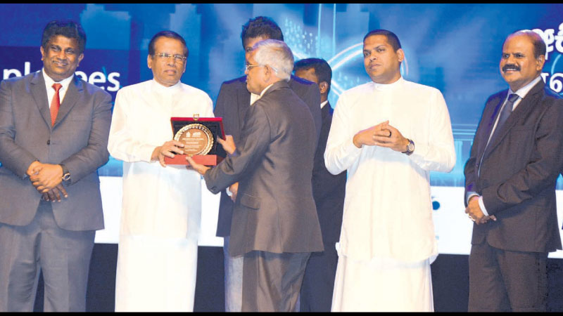 During the event, Governor, Central Bank, Dr. Indrajit Coomaraswamy was recognized with an award for his contributions to digitalizing of Sri Lanka project by President Maithripala Sirisena. Minister of Digital Infrastructure and Information Technology, Ajith P. Perera, Minister of Telecommunication, Foreign Employment and Sports, Harin Fernando, Group Chairman SLT, P.G. Kumarasinghe Sirisena are also in the picture. Picture by Sudath Malawera