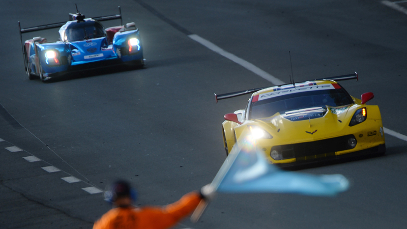 (From R) Spanish driver Antonio Garcia steers his Chevrolet Corvette C7R ahead of Russia' driver Mikhail Aleshin on his BR Engineering BR1 AER LMP1 during the free practice session at Le Mans in northwestern France on Wednesday, prior to the 87th edition of the 24 Hours Le Mans endurance race. - AFP
