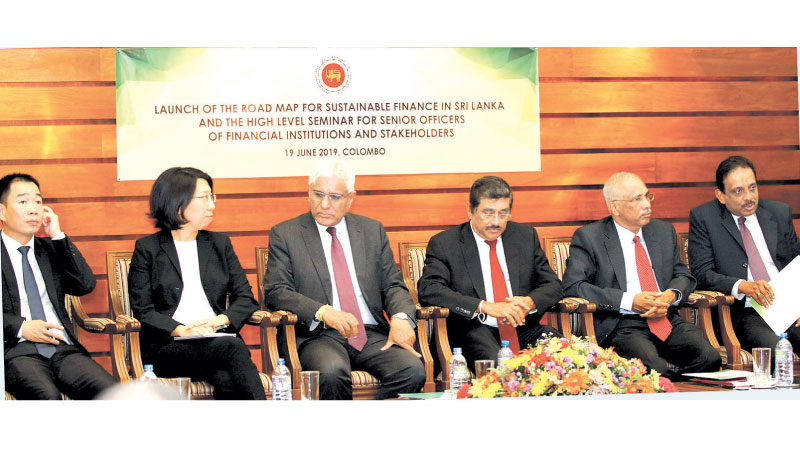 Central Bank  Governor Dr. Indrajit Coomaraswamy, Senior Deputy Governor Dr. Nandalal Weerasinghe, Wei Yuan, representative of the SBN Global  Secretariat and the Coordinator for Asia Region and Measurement Working Group and other senior officials at the launch of the Roadmap for Sustainable Finance In Sri Lanka. Pictures by Sulochana Gamage