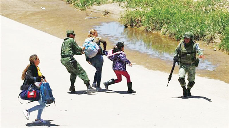 Mexican National Guard members prevent Central American migrants from crossing the Rio Bravo, in Ciudad Juarez, Chihuahua State.
