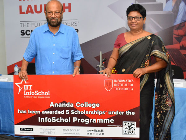 A member of the tutorial staff of Ananda College, accepting the scholarship on behalf of the school by Professor Gamini Wickramasinghe Picture by: Sarath Pieris.