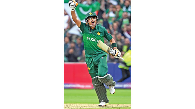 Pakistan's Babar Azam celebrates after scoring a century (100 runs) during the 2019 Cricket World Cup group stage match between New Zealand and Pakistan at Edgbaston in Birmingham, central England, on June 26. AFP