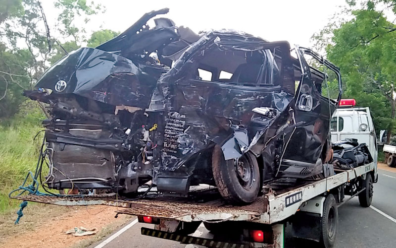 The van that had been crushed beyond recognition in the road collision in Moragoda, near Anuradhapura last morning.