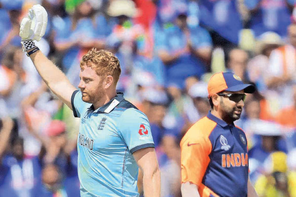 England's Jonny Bairstow celebrates after scoring a century (100 runs) during the 2019 Cricket World Cup group stage match between England and India at Edgbaston in Birmingham, central England, on June 30. AFP