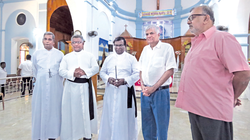 Prime Minister Ranil Wickremesinghe with the clergy during his visit to St. Mary's Cathedral, Batticaloa. Pictures by Sivam Packiyanathan, Batticaloa Special Corr.