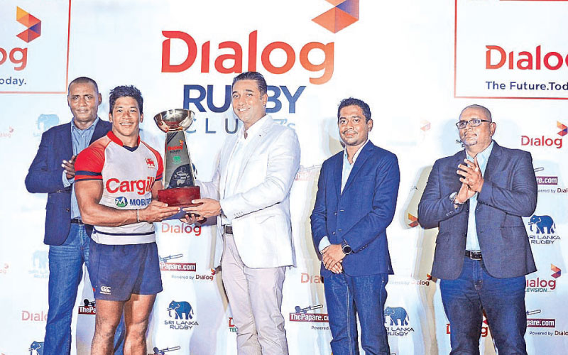 Harsha Samaranayake, Senior General Manager – Brand & Media, Dialog Axiata PLC, handing over the Sevens cup championship to Nigel Ratwatte captain of Kandy SC. Nazeem Mohamed – Vice President, Sri Lanka Rugby, Thisara Kasthuriarachchi - General Manager - Mobile Broadband and Pre-Paid Mobile Business - Dialog Axiata PLC and Thusitha Peiris – Honorary Secretary, Sri Lanka Rugby are also present. Picture by Sudam Gunasinghe