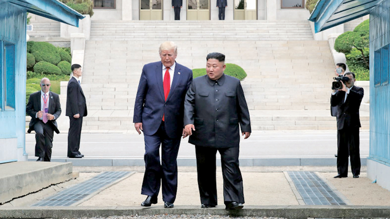 North Korean leader Kim Jong Un and U.S. President Donald Trump inside the Demilitarized Zone separating the South and North Korea on June 30.