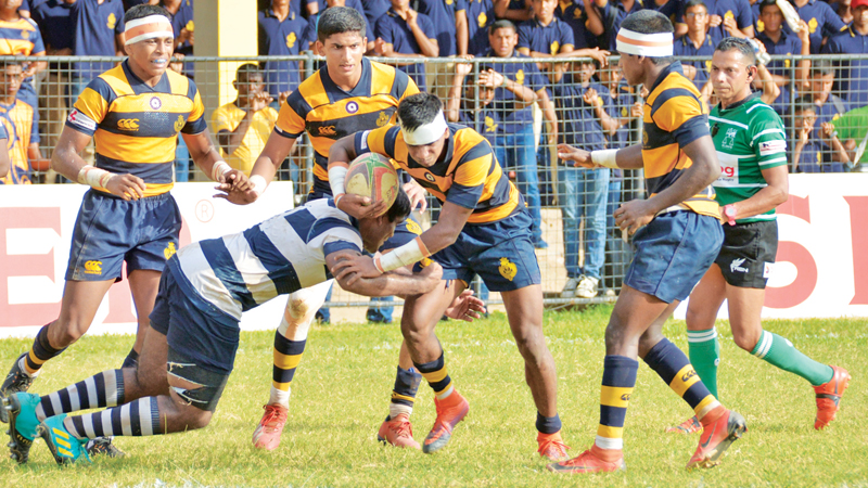 Priyantha Gunaratne watches the action closely during the Royal vs  St. Joseph's inter-school rugby match at Royal Sports Complex on Saturday.  (Picture by Saman Mendis)