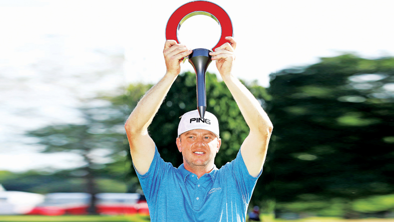 Nate Lashley celebrates with the trophy after winning the Rocket Mortgage Classic at the Detroit Country Club on June 30, 2019 in Detroit, Michigan.  AFP