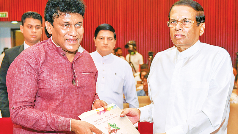 President Maithripala Sirisena and Minister Mano Ganeshan at the Official Languages Day ceremony, at the BMICH on Monday. Picture courtesy President's Media Division