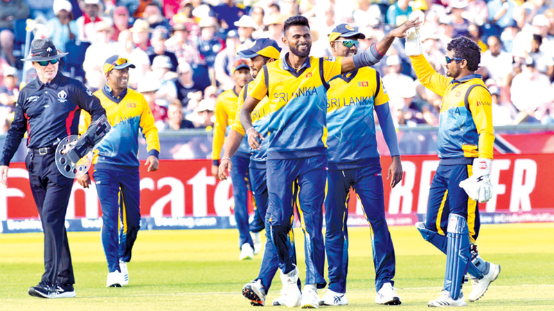 Sri Lankan players celebrate their win over West Indies by 23 runs.