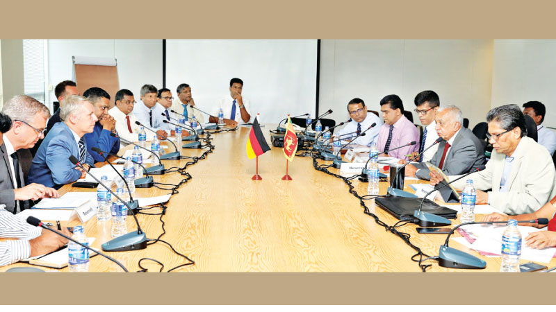 Minister of Development Strategies and International Trade Malik Samarawickrama, Chairman BOI, Mangala Yapa,  Additional Secretary to the Ministry, W. A. D. S. Gunasinghe and other officials at the event