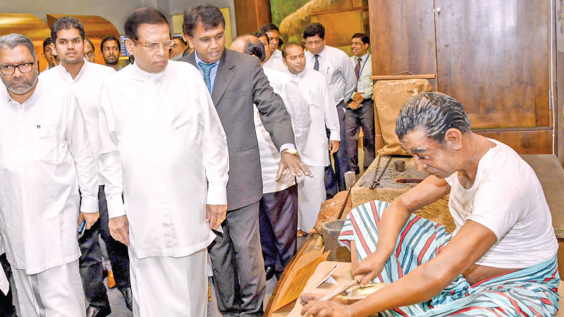 President Maithripala Sirisena who opened the country's first ever museum of ancient technology and library in Polonnaruwa yesterday viewing one of the exhibits on display. Picture by Sudath Silva