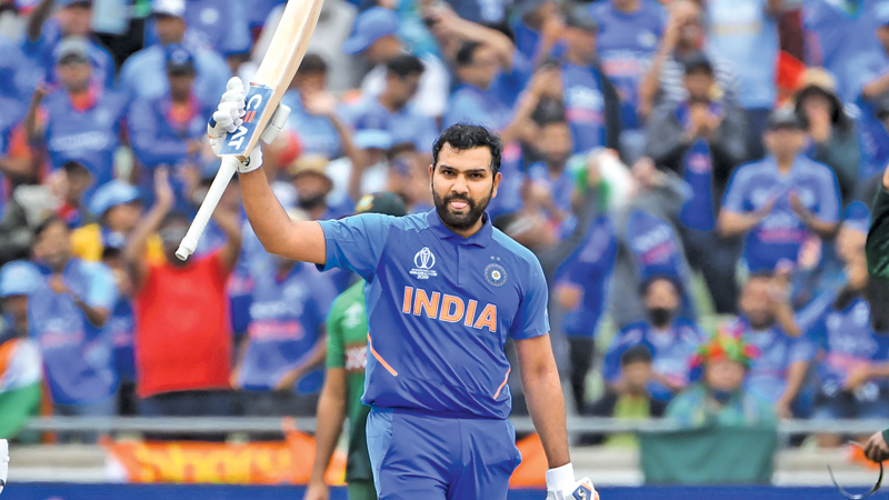 India's Rohit Sharma celebrates making his century during the 2019 Cricket World Cup group stage match between Bangladesh and India at Edgbaston in Birmingham, central England, on July 2. - AFP