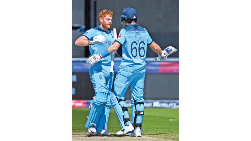 England's Jonny Bairstow (L) embraces teemmate Joe Root as he celebrates after scoring a century (100 runs) during the 2019 Cricket World Cup group stage match between England and New Zealand at the Riverside Ground, in Chester-le-Street, northeast England, on July 3. AFP