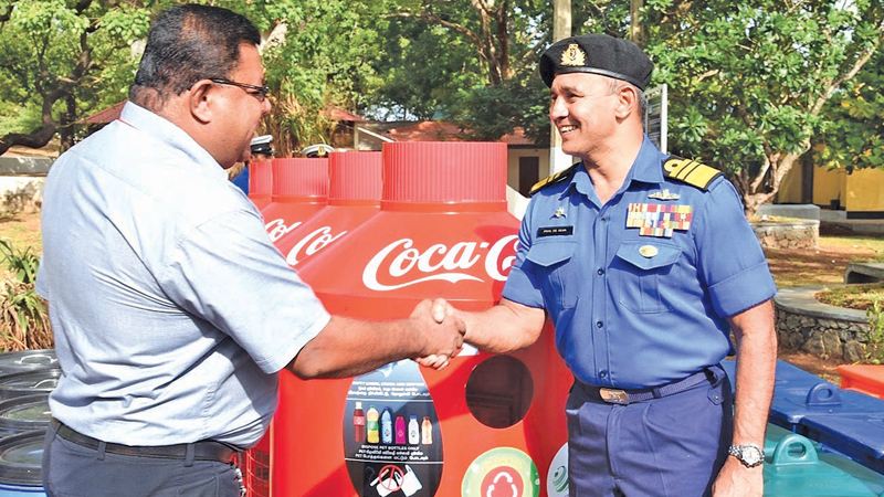 The 'Give Back Life' PET collection bins being handed to Stanley Balasundaram Regional Sales Manager (East) (Coca-Cola Beverages Sri Lanka Ltd.) and  Vice Admiral Piyal De Silva, WWV and Bar, RWP, RSP, VSV, USP, NDU - The Commander of the  Sri Lanka Navy.