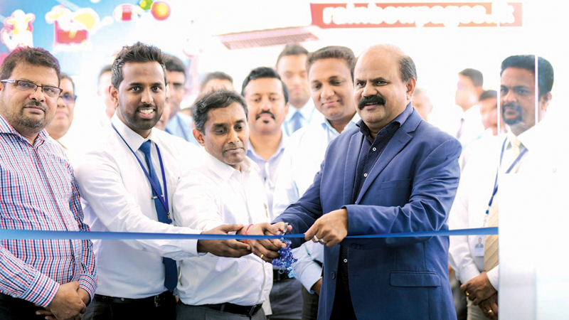 Chairman of SLT Group, P.G. Kumarasinghe Sirisena with officials opens the revamped office in Nuwara Eliya.
