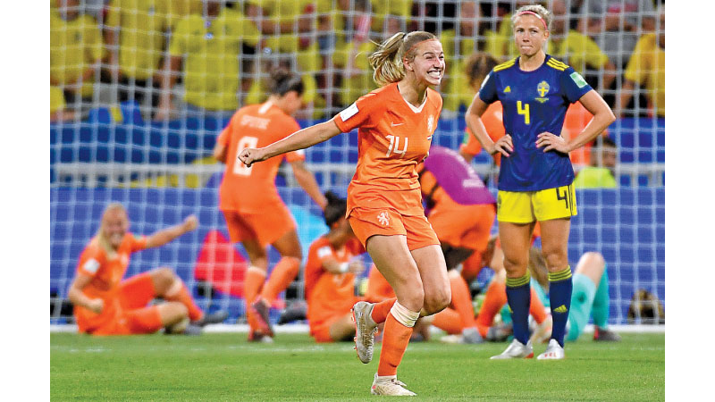 Netherlands' midfielder Jackie Groenen (C) celebrates after winning the France 2019 Women's World Cup semi-final football match between the Netherlands and Sweden, on July 3. AFP