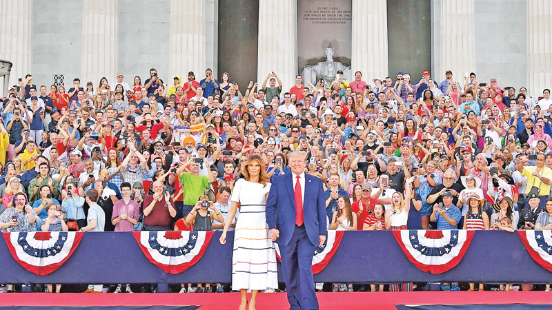 "US President Donald Trump and First Lady Melania Trump arrive for  the ""Salute to America"" Fourth of July event at the Lincoln Memorial in Washington, DC on Thursday. - AFP"