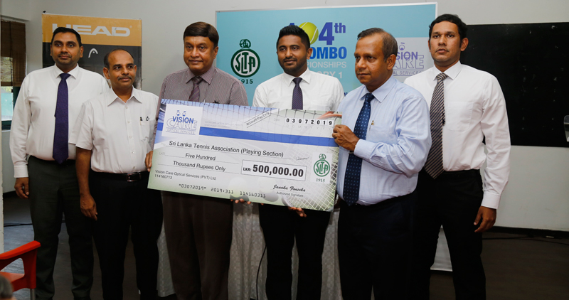 The President of SLTA (Playing Section) Ayendra Bandaranaike (third from left) receiving the sponsorship cheque from Managing Director of Vision Care (Pvt) Ltd Janaka Fonseka (second from right) at a media briefing held at the Sri Lanka Tennis Association on Wednesday. Also in the picture are (from left) Director of 3G Sports Surya Bibile, General Secretary of SLTA (Playing Section) Pradeep Gunasekara, Marketing and Customer Care Assistant Manager of Vision Care Dlon Nedorff and Tournament Director Udith Wi
