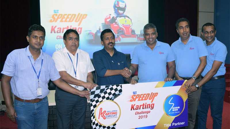 Officials of Sri Lanka Telecom PLC, Ceylon Motor Sports Club and David Pieris Racing and Leisure (Pvt) Ltd during the press conference on Friday.