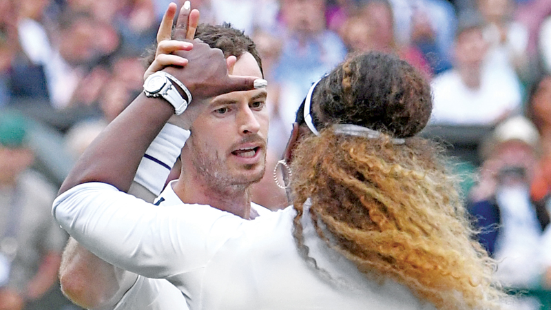 Britain's Andy Murray (L) and US player Serena Williams (R) celebrate beating Germany's Andreas Mies and Chile's Alexa Guarachi during their mixed doubles first round match July 6.