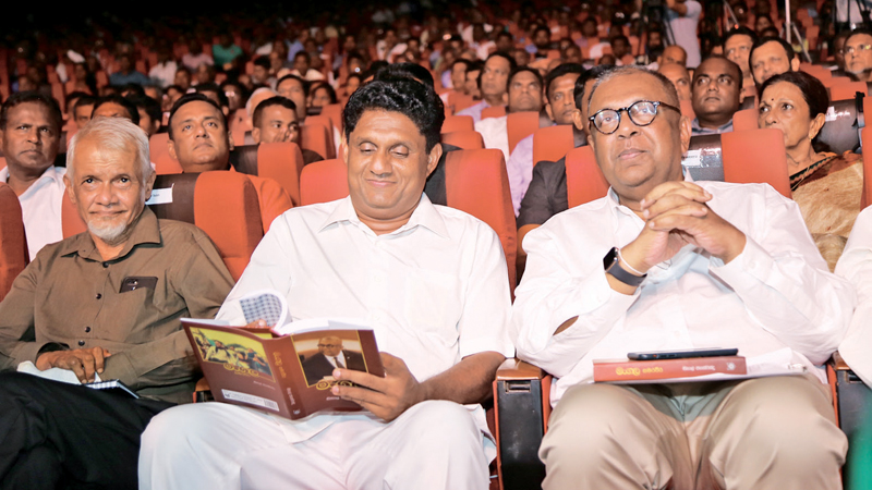 Housing Construction and Cultural Affairs Minister Sajith Premadasa and Finance Minister Mangala Samaraweera at the launch of Khema's boy - three decades of politics at the Rabindranath Tagore Memorial Ceremony Hall of the Ruhunu University on Sunday