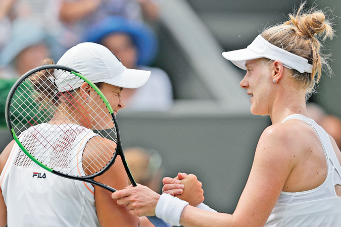 US player Alison Riske (R) shakes hands with Australia's Ashleigh Barty (L) after Riske won their women's singles fourth round match on the seventh day of the 2019 Wimbledon Championships at The All England Lawn Tennis Club in Wimbledon, southwest London, on July 8. AFP