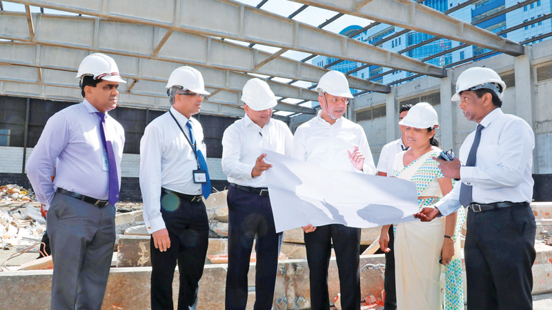 Ports, Shipping and Southern Development Minister Sagala Ratnayaka inspecting the land area allocated for the construction of planned 17 storey building complex