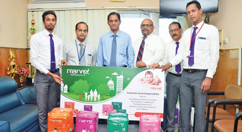 (From the left) Digital Marketing Executive of Marvel Marketing Krishanth, Pediatric Cardiologist of Lady Ridgeway Dr Shehan Perera, Senior Consultant Dr Ajith Dantanarayana, Director of Marvel Marketing VN Sivendran, Manager Gemunu Abeygunewardena and Modern Trade -Marketing Executive Dimuthu Rangana.