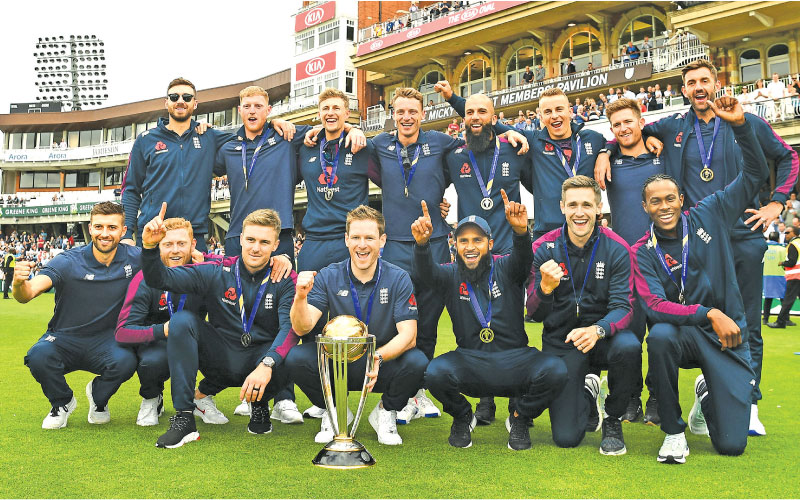The new World Cup cricket champions England celebrate their victory.  - AFP