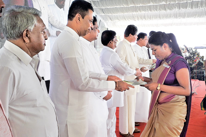 A graduate is presented her appointment letter at the function. Picture by Mahinda P. Liyanage, Galle Central Special Corr.