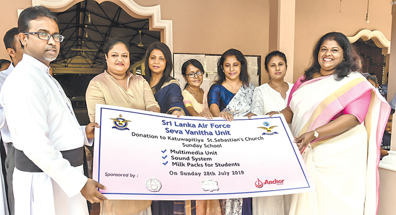 Members of the SLAF Seva Vanitha Unit and a priest of Sebastian's Church, Katuwapitiya, at the presentation of the donation. Picture courtesy SLAF