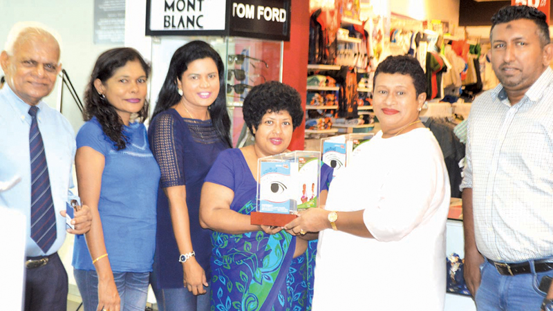 Cool Planet Directress Ramma Wickrama hands a till to HelpAge Fund Raising Manager Ruchilalani Batuwantudawa. Cool Planet Business Development Manager Imran Iqbal and HelpAge officials Priyadharshani Bulathsinhala, Manoji Galappaththi and Tissa Silva are also in the picture.