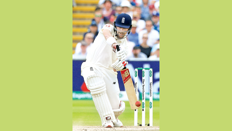 England's Rory Burns plays a shot on the second day of the first Ashes cricket Test match against Australia at Edgbaston, Birmingham on Friday. – AFP