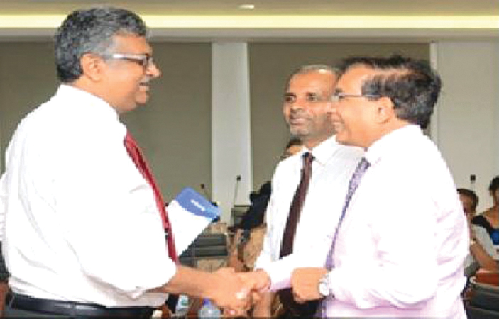 Vice Chancellor of University of Sri Jayewardenepura Senior Prof. Sampath Amaratunge (L) shakes hands with Prof. Terrence Perera (R-Front) from Sheffield Hallam University and Dr U. Anura Kumara (R-Back), Dean of the Faculty of Management Studies and Commerce, University of Sri Jayewardenepura