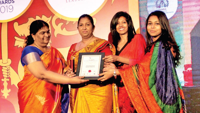 Nayanthi Kodagoda, General Manager, HR & Administration at CDB receiv the award from P.S.M. Charles, Director General of Sri Lanka Customs, flanked by  Hasini Pathiranage, Deputy Manager HR, CDB,   Chathuri Weththasinghe, Senior Executive HR, CDB.