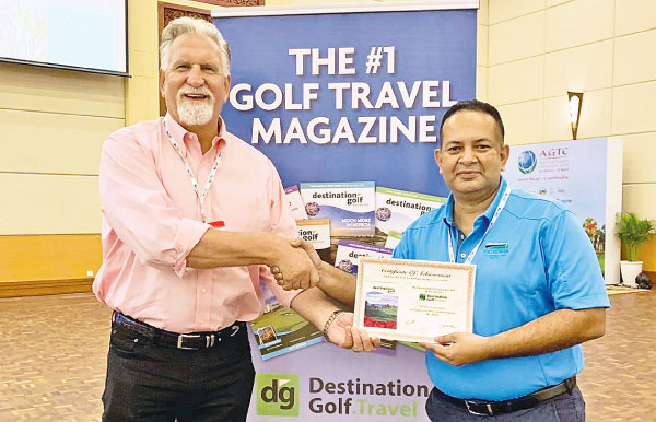 """Asela Wavita, General Manager of The Victoria Golf & Country Resort, being presented the certificate for the """"Most Memorable Golf Course in Asia 2019"""" by  Sam Sokocius, Member of the Panel of Judges and Golf Travel Writer of Destination Golf."""