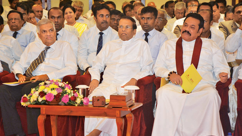 A national ceremony to hand over a set of practical guidelines for the selection of candidates for forthcoming elections was held at the BMICH on Tuesday. The guidelines have been discussed and unanimously agreed upon and approved by the Most Venerable Mahanayake Theras of the three Chapters, Colombo Archbishop Malcolm, Cardinal Ranjith, the Bishop of the Anglican Church and representatives of the Hindu and Muslim religions. Here, Prime Minister Ranil Wickremesinghe, President Maithripala Sirisena and forme
