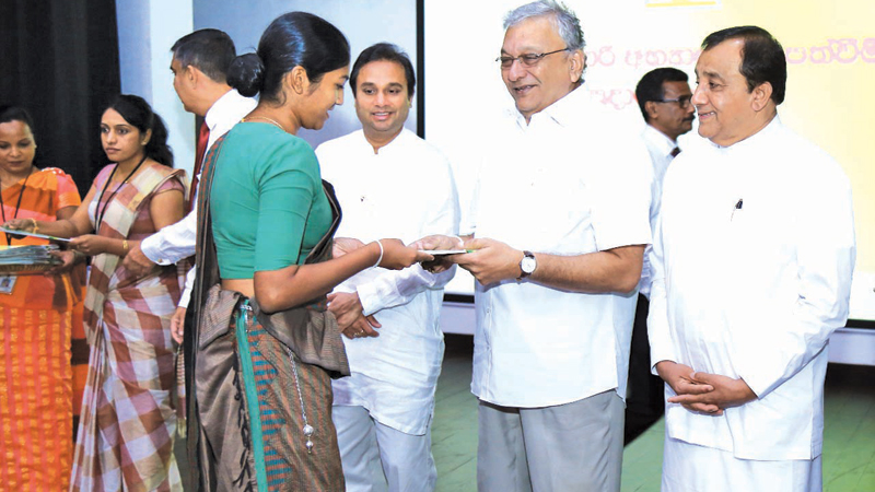 Leader of the House, Public Enterprise, Kandyan Heritage and Kandy Development Minister Lakshman Kiriella presenting the appointment letter to a graduate at the Kandy District Secretariat.