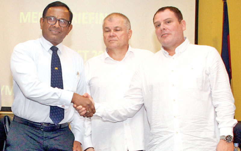 Maj. Gen. Dampath Fernando (left), HFSL president greeting Serbian coaches Matic and Nenad at a press conference at Olympic House yesterday.  (Picture by Sulochana Gamage)