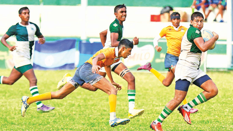 Action from last year's Plate final between Isipathana and St. Peter's