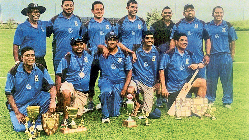 The Old Thomian cricket team is seen here with the Mustangs Trophy and other trophies soon after the match. (Picture by Dilwin Mendis)