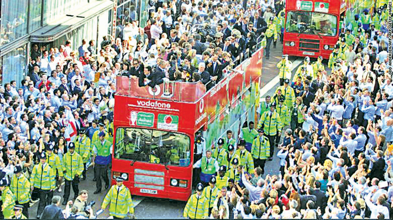 England's cricket team rides in an open top double decker bus through London after winning the 2005 Ashes.