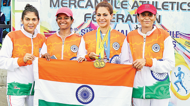The Indian over 45 women's 4 x 100m relay team comprising Caroline Vincent, Sharada Kale, Lavina Hansaraj and Dr. Pallavi Moog displaying their silver medal at the Mercantile Athletics Championships held at the Sugathadasa Stadium on Sunday.