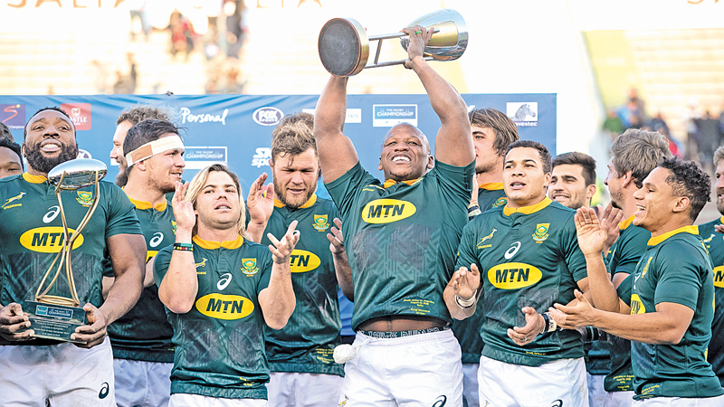 South African's players clebrate after winning the Rugby Championship at the end of a match against Argentina in Salta, Argentina, on Saturday. - AFP