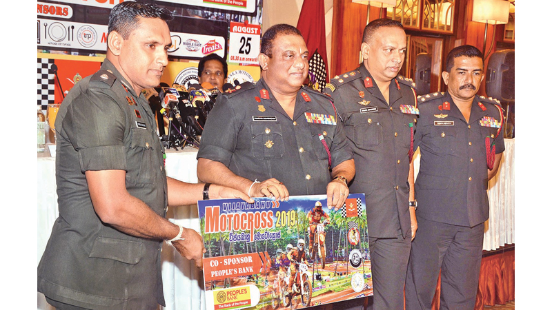 The Commandant of the Vijayabahu Regiment Major General Chandana Gunawardena (second from left) is seen here with the sponsorship cheque of the main sponcer Airvoice limited at the press briefing held at Taj Samudra Hotel. Picture Sudath Malaweera.