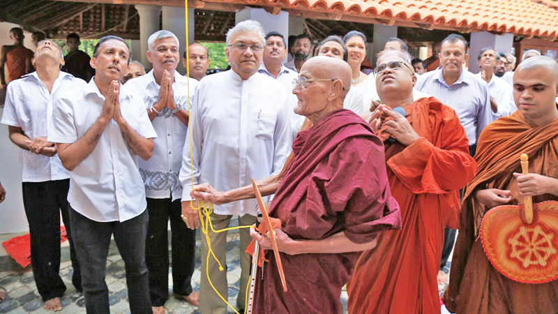 Leader of the House, Public Enterprise and Kandyan Heritage Development Minister Lakshman Kiriella at the opening of the library and Sanghavasa at Sri Nelumpathhinna Isipathanarama Temple yesterday.